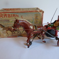 ARABIAN wind-up horse and trotting cart