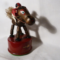 Collapsing horse & jockey toy 1930's